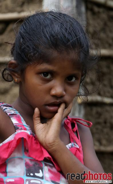 Cute little village girl looking, Sri Lanka