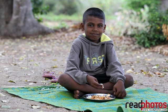 Happy boy having a meal, Panama, Sri Lanka - Read Photos