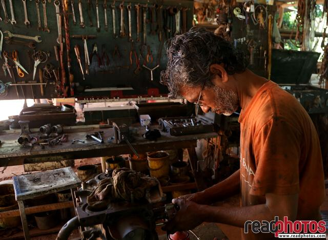 Mechanic working in a garage, Sri Lanka(2) - Read Photos