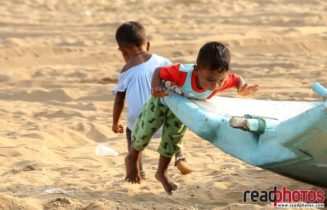 Little kids playing at the beach, Sri Lanka