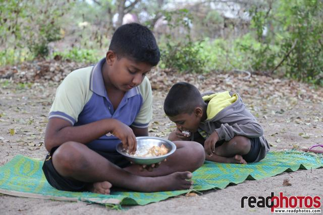 Two brothers having lunch, Sri Lanka