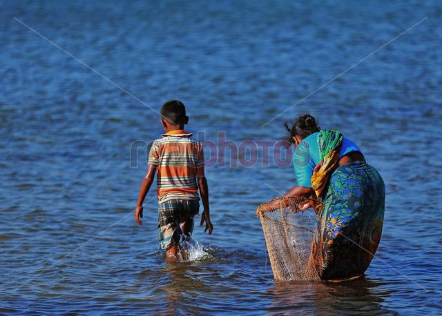 Mother and son fishing, Sri Lanka