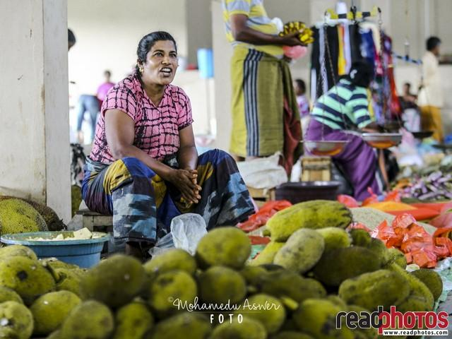 Lady seller in a market, Sri Lanka