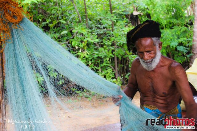 Fisherman with his fishing net, Sri Lanka