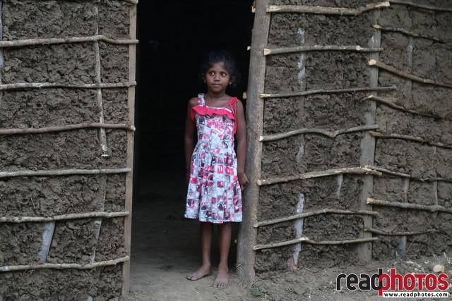 Little girl in her house, Welikanda, Sri Lanka