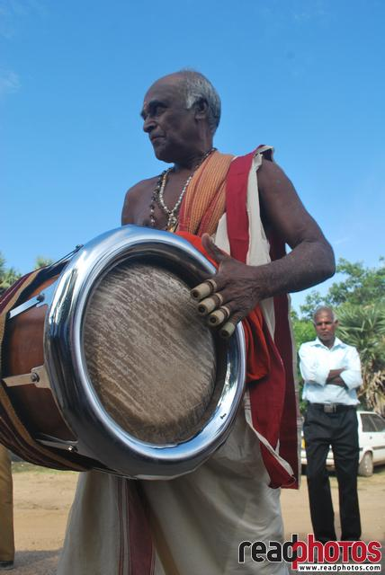 Man playing a traditional hindu drum, Sri Lanka