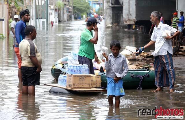 Little boy collecting flood rations, Sri Lanka