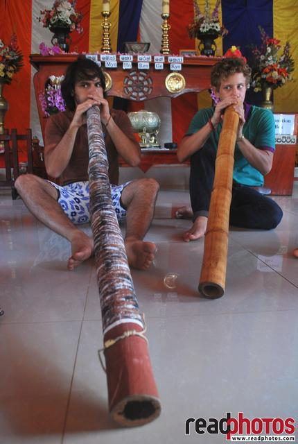 Men playing air flutes, Sri Lanka