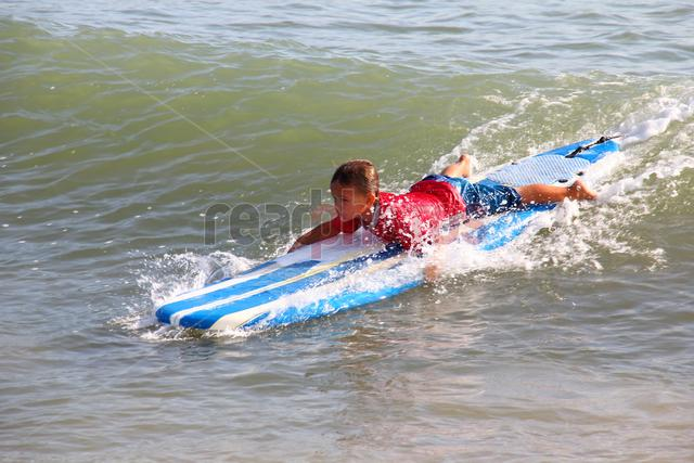 Young boy surfing , Arugambe in Sri Lanka