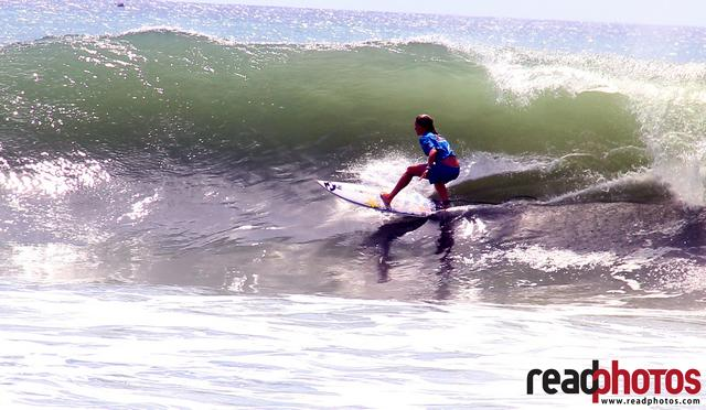 young girl sea surfing on a giant wave, Arugambe, Sri Lanka - Read Photos
