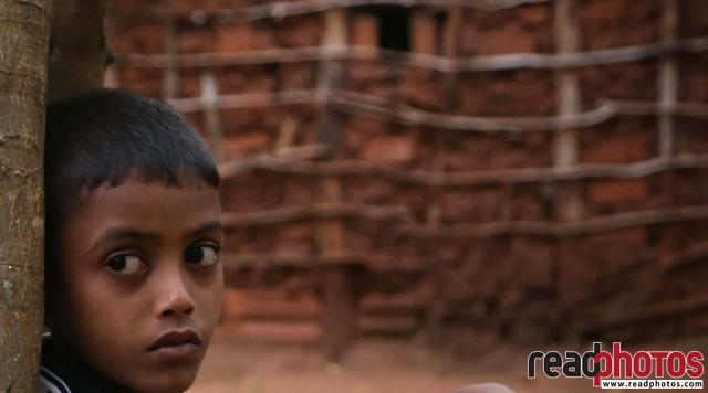 Young boy looking at the road, Anuradhapura, Sri Lanka - Read Photos