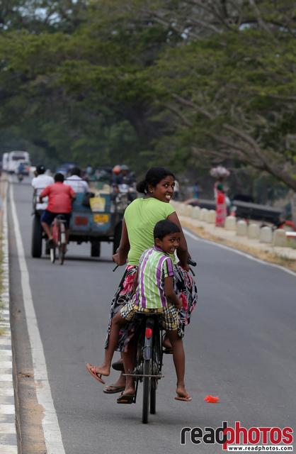 Mom and son rides along the road, Sri Lanka - Read Photos