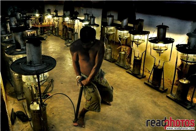 Man igniting a Lamp, Sri Lanka