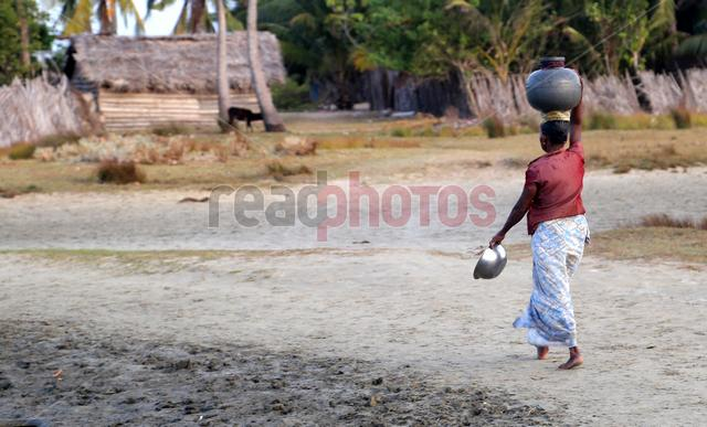 Water pot carrying lady