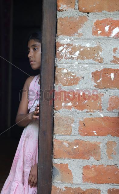 Young girl thinking, Sri Lanka