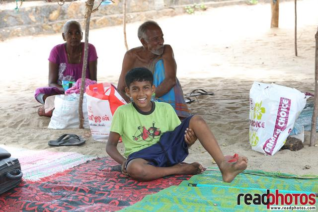 Smiling boy in a temporary hut, Sri Lanka
