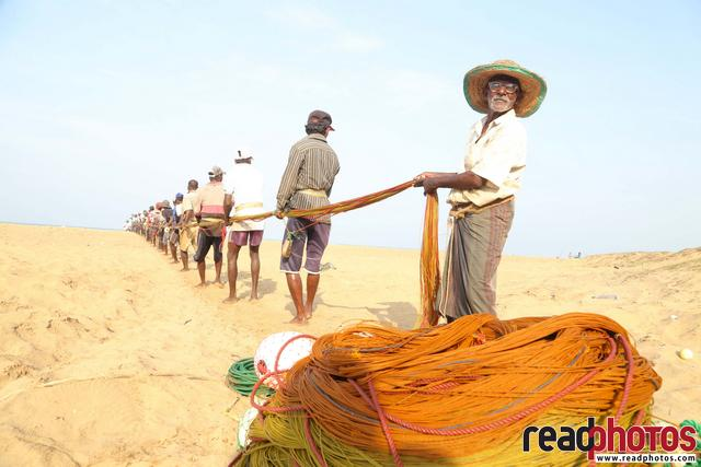Fishermen puling a fishing net  - Read Photos