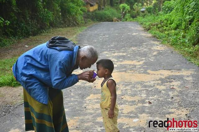 Grandfather feeding grandson