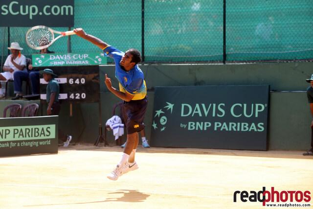 Tennis player in action, Sri Lanka - Read Photos