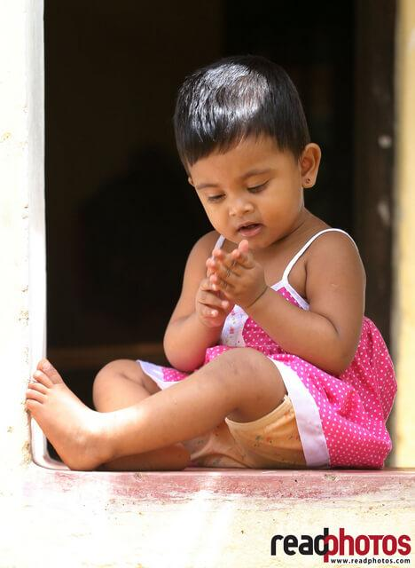 Cute young girl in a happy mood, Gampaha, Sri Lanka - Read Photos
