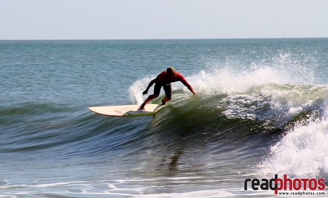 Young man surfing in Arugambe, Sri Lanka