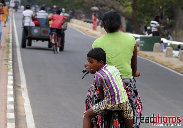 Mom and son rides along the road, Sri Lanka (2)