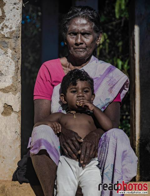 Child with grandmother, Sri Lanka