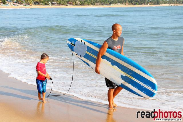 Father and son surfing, Arugambe in Sri Lanka (2)