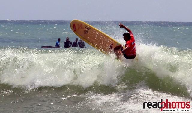 Man surfing on a big sea wave, Arugambe, Sri Lanka - Read Photos