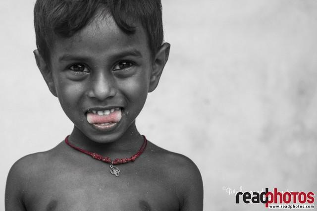 Happy young boy, Sri Lanka - Read Photos