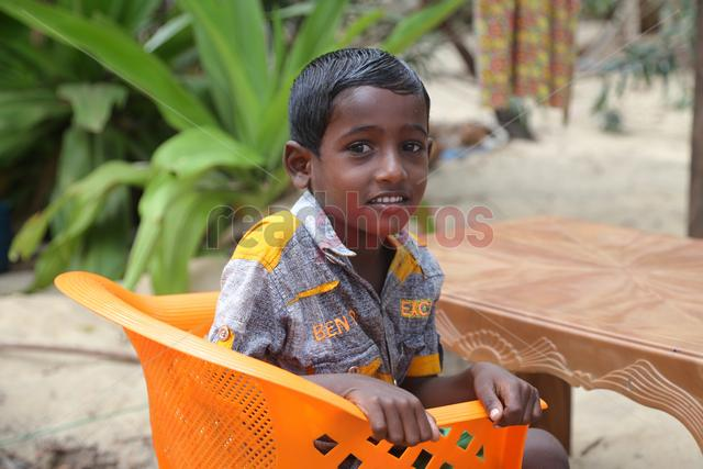Sri Lankan happy boy - Read Photos