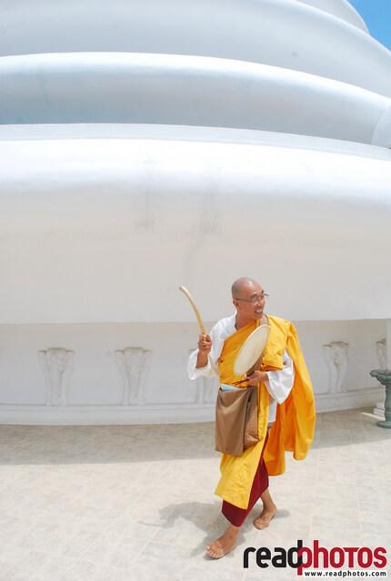 Mahayana Buddhist monk at a pagoda, Sri Lanka