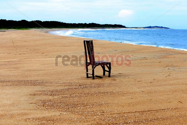 Chair and sea, Arugambe, Sri Lanka