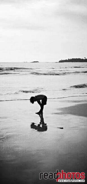 Boy on the beach, black and white, Sri Lanka