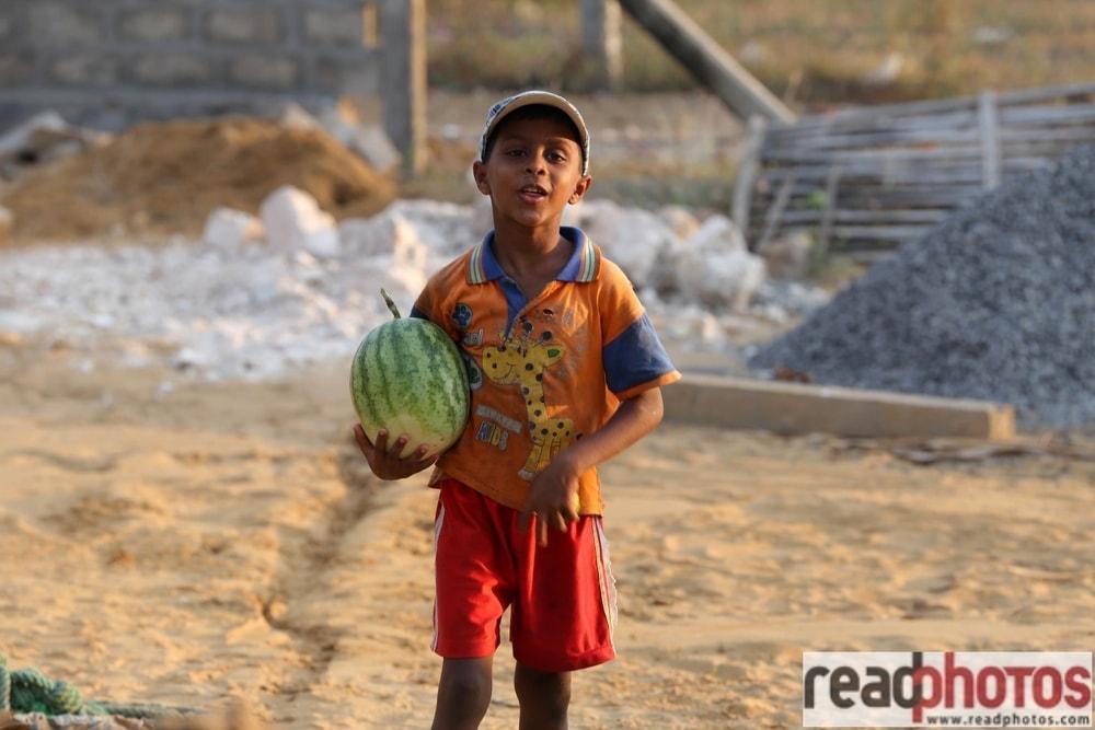 Boy holding a watermelon - Read Photos