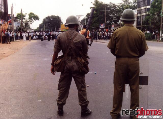 Opposition protest 90s, two policemen, Sri Lanka