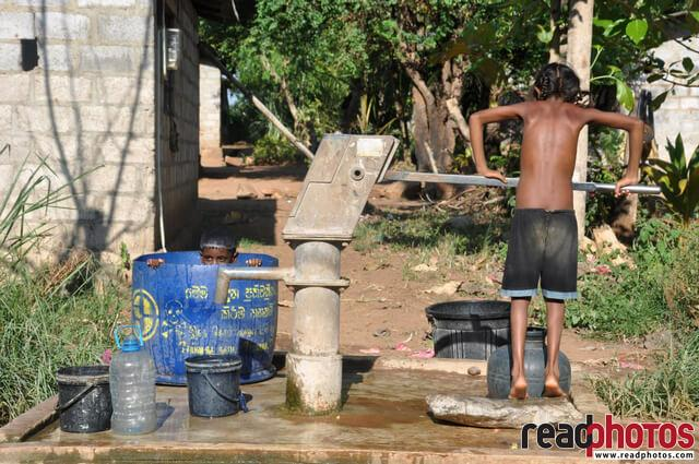 Children bath from a tube well, Sri Lanka - Read Photos