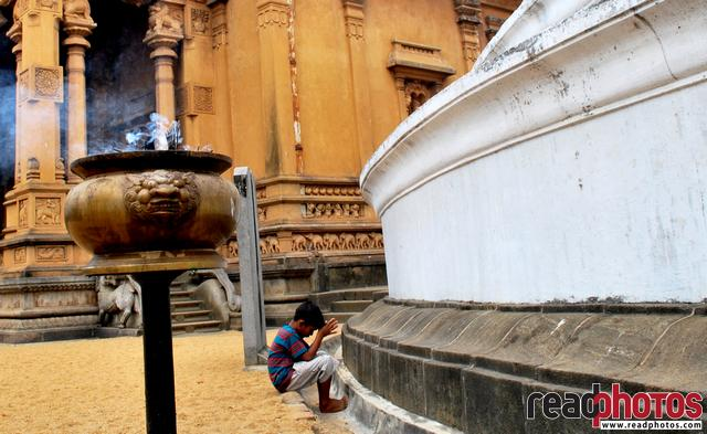 Young boy in Kaleni temple, Sri Lanka