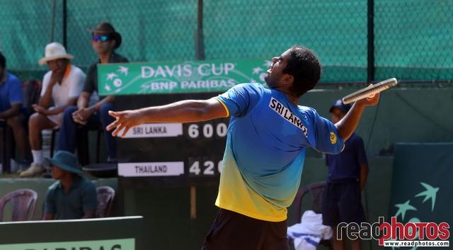 Sri Lankan tennis player play hard