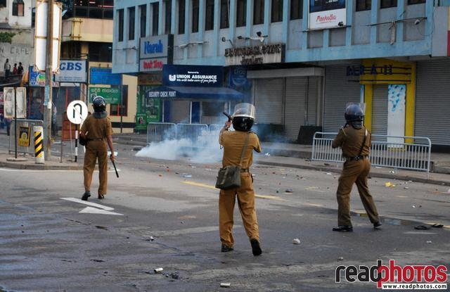 Policemen firing, protest in Sri Lanka