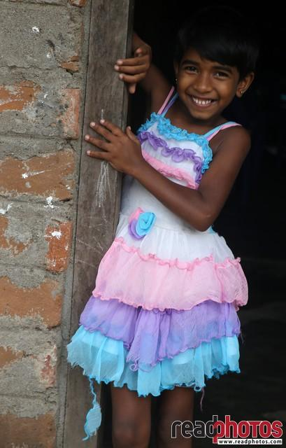 Smiling girl in a house, Welikanda, Sri Lanka