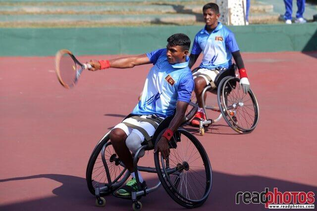 Strong handicapped man paying tennis, Sri Lanka - Read Photos
