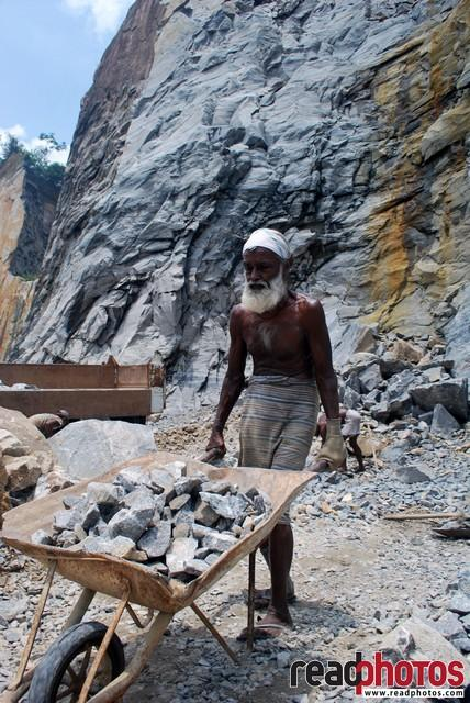 Old man working in a quarry, Sri Lanka - Read Photos