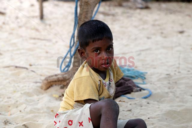 Boy on the beach, Sri Lanka - Read Photos