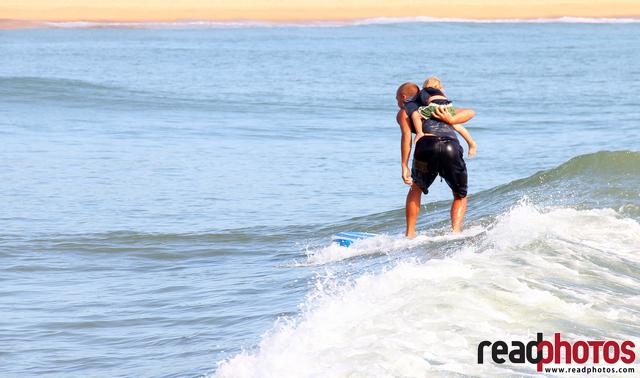 Father and son surfing, Arugambe in Sri Lanka (3)