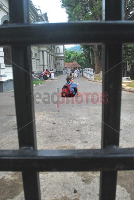 Young white boy waiting, Sri Lanka