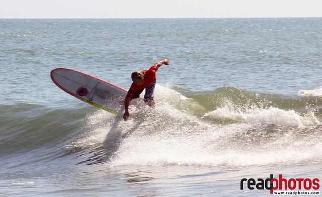 Strong lad Surf in Arugambe, Sri Lanka  - Read Photos