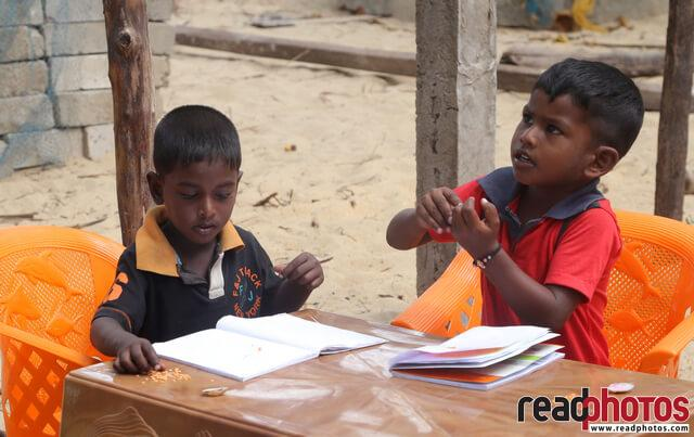 Two boys studying, Sri Lanka