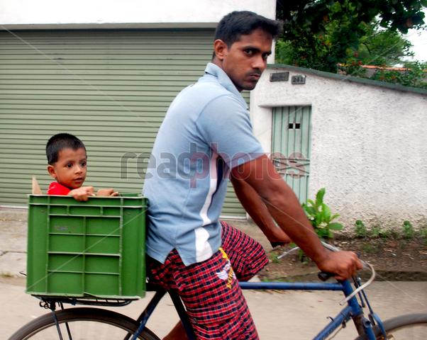 Father and son, Minuwangoda, Sri Lanka
