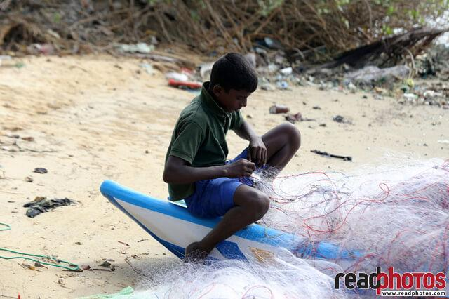 A young boy getting ready to fish, Sri lanka - Read Photos